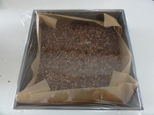 Nanaimo bar base wrapped in plastic