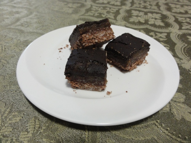 Experimental hypo-allergenic nanaimo bars on a plate