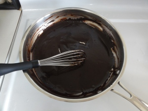 Coconut oil, cocoa powder, and maple syrup