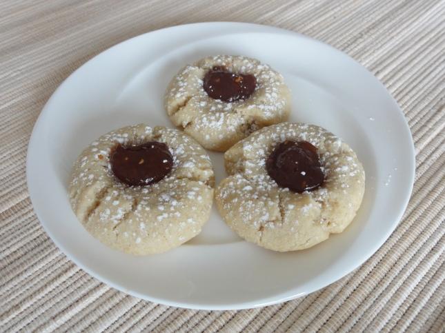Raspberry almond thumbprint cookies on a plate