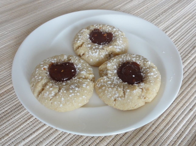 Raspberry almond thumbprint cookies on a plate
