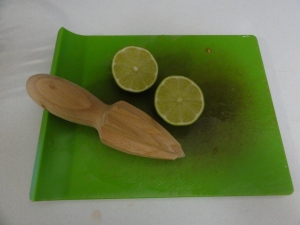 Limes and a citrus reamer
