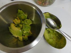 Avocado spooned into a bowl