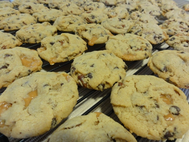 Chocolate chip caramel pecan cookies on a cooling rack