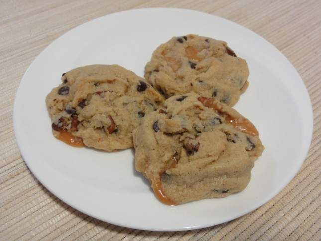 Chocolate chip caramel pecan cookies on a plate
