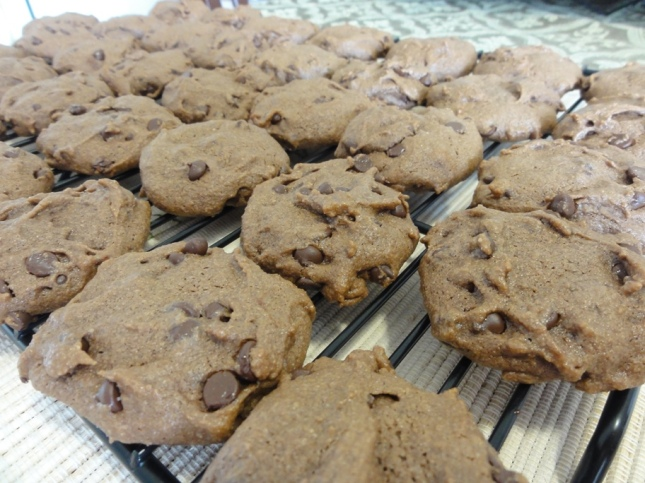 Baked double chocolate tahini cookies on a cooling rack