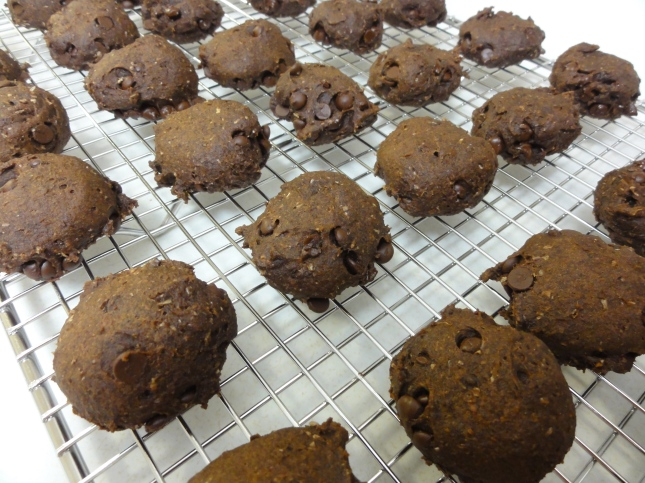 Vegan chocolate pumpkin spice cookies on a cooling rack